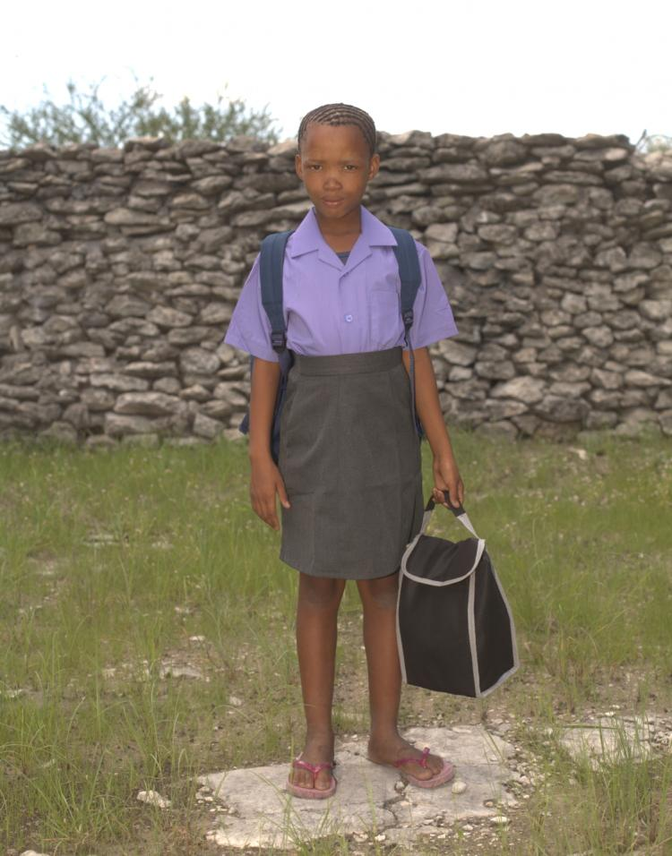 Di//xao Oma coming from the Bense Kamp Village School on her first day of school in Tsumkwe.